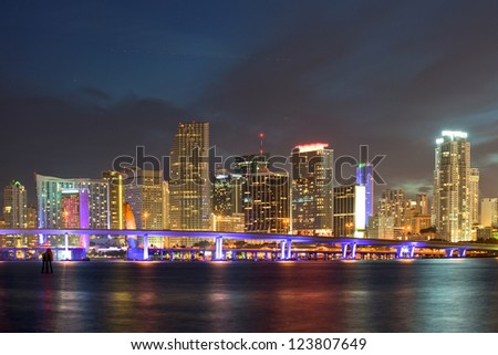Miami Florida  downtown illuminated business and luxury residential buildings, hotels and Biscayne Bay bridge.Night Cityscape of World famous travel location.
