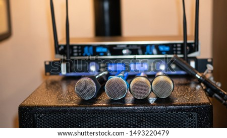4 microphones placed next to the audio equipment