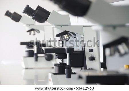 3 microscopes in laboratory for micro organisms.