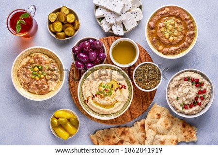 Middle eastern, arabic traditional breakfast with hummus, foul, mutabbal, qudsia and zaatar. Top view                               Сток-фото ©