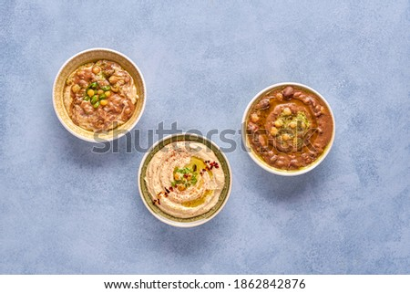 Middle eastern, arabic traditional chickpea dishes hummus, foul,  and qudsia. Top view with copy space                               Сток-фото ©