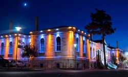 midnight blue and lighted stone building