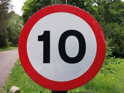 10 miles or kilometers an hour road sign