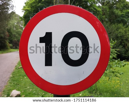 10 miles or kilometers an hour road sign Foto stock ©