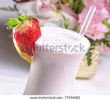 Milk shake with fresh strawberries