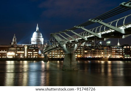 Millennium bridge and St. Paul cathedral in London at night