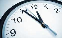 5 min before 12 o`clock on a wall clock