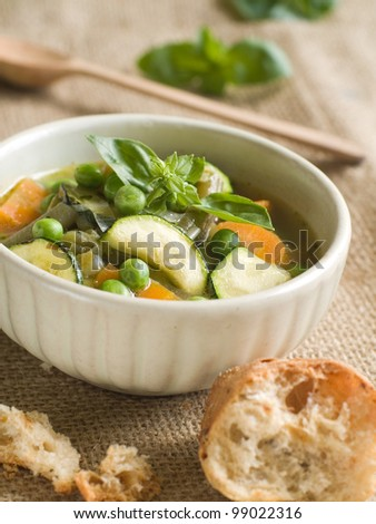 Minestrone soup with celery, carrots, onions, green beans and zucchini, selective focus