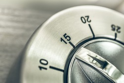 15 Minutes - Quarter Hour - Macro Of An Analog Chrome Kitchen Timer On Wooden Table