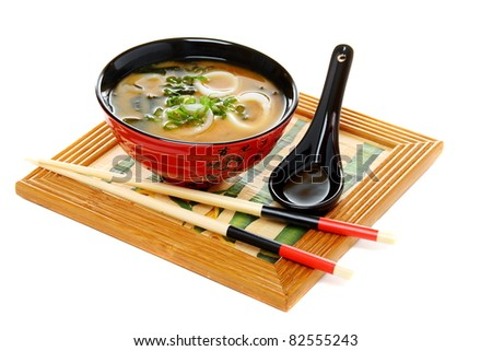 Miso soup with green onion isolated on white background