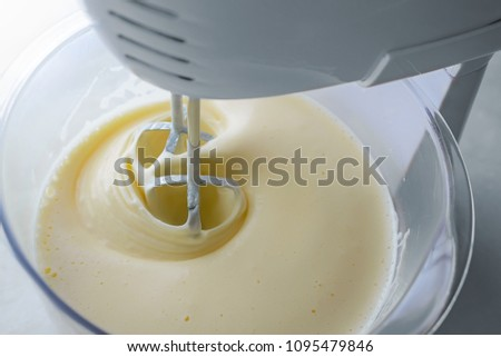 mix biscuit dough with a electric mixer Stock photo ©