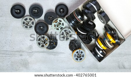 8mm and Super 8, box  on wood background