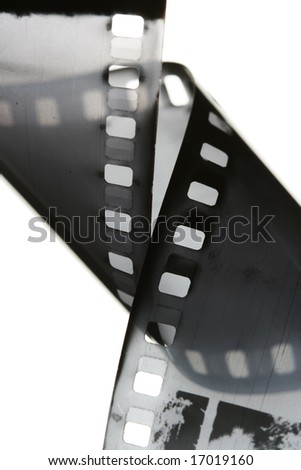35 mm black and white film isolated over white background - stock photo