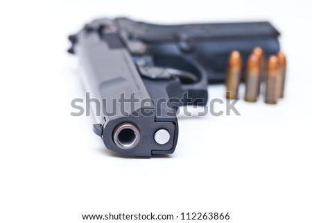 9 mm Black handgun isolated on a white background.