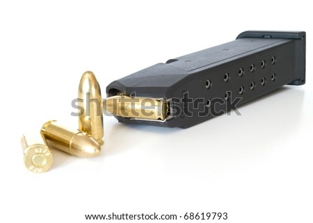 9mm bullets and magazine isolated on white