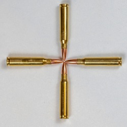 5.56mm bullets arranged in the shape of crosshairs