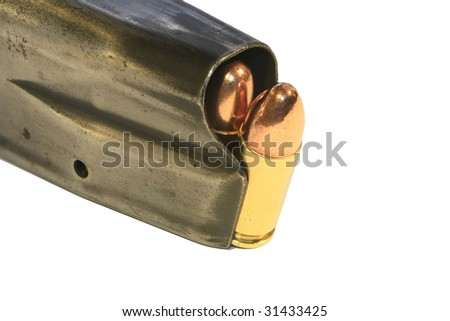 9mm bullets in a magazine, isolated on white