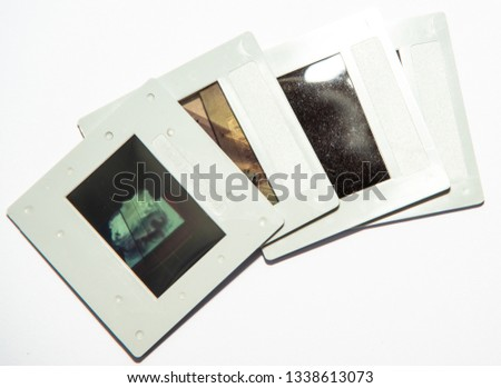 35mm color transparency slide film, mounted in white plastic mounts.  analogue vintage records of memories or hobbies going back to the 1960s & 1970s. Now obsolete, out of fashion with digital photos #1338613073
