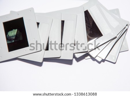 35mm color transparency slide film, mounted in white plastic mounts.  analogue vintage records of memories or hobbies going back to the 1960s & 1970s. Now obsolete, out of fashion with digital photos #1338613088