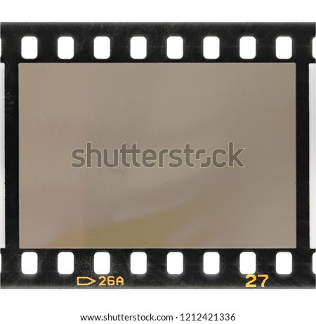35mm dia film frame or strip, just blend in your own picture to make it look old