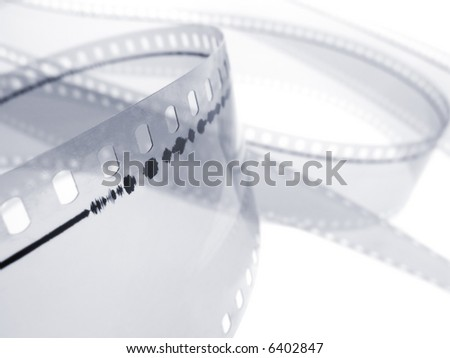 35 mm film audio track isolated in white background. Shallow depth of field. Macro shot