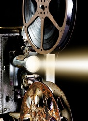 16mm film projector from the 1940's playing with bright lights.