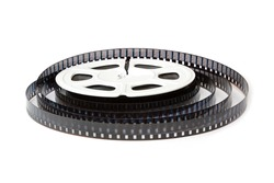 8mm film reel with film strips scattered around. Close-up image isolated on white background.