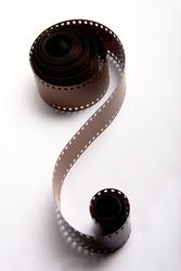 35mm film rolls on white background