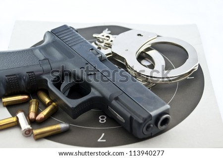 9-mm handgun automatic and police handcuff with bullets  on white background