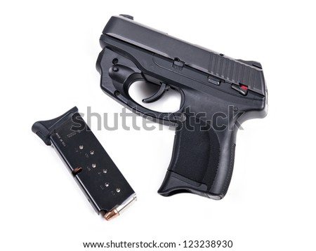 9mm Handgun isolated with a filled magazine.