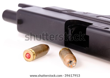 9mm hollow point bullet and a pistol with the slide back on a white background