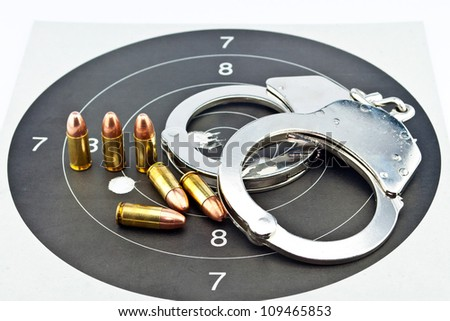 9mm Luger Ammunition and Handcuffs on target