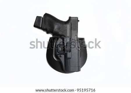 9mm pistol in a holster