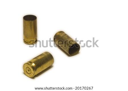9 mm pistol shell casings on white background