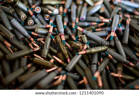 5.56mm rifle bullet. Army supplies. Military war background. Ammo