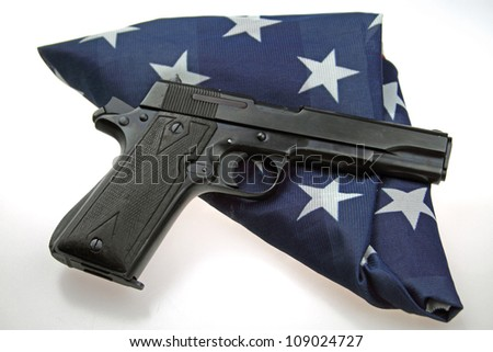 9mm semiautomatic pistol with folded American Flag