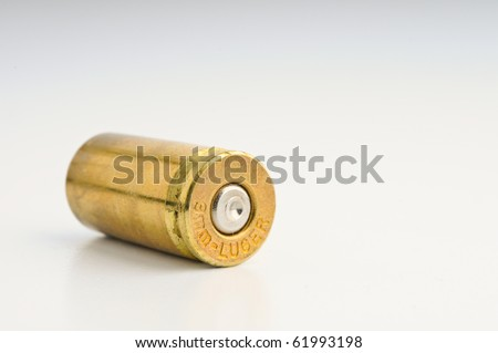 9mm Shell casing against gradient - stock photo