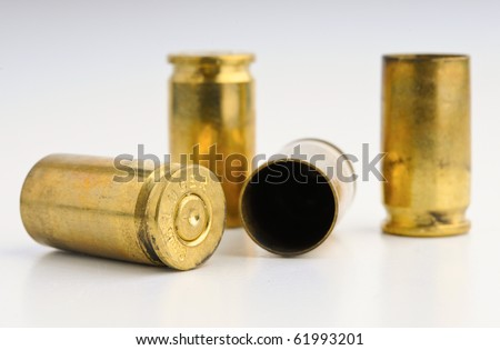 9mm Shell casings against gradient - stock photo