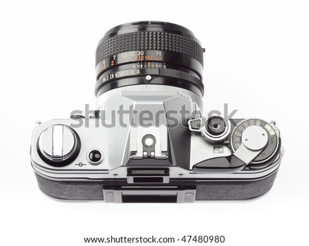 35mm SLR camera, seen from above, on a white background
