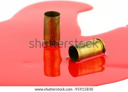 9mm spent shells and blood studio shot