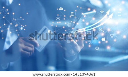 Mobile banking network, online payment, digital marketing. Business people using mobile phone with credit card and icon network connection on dark blue virtual screen background, business technology
