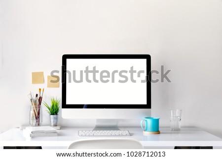 Mockup of creative desktop of designer with coffee mug. #1028712013