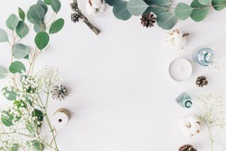 Mockup on a grey background  with gentle flowers and plants. Cute feminine mockup. Blog header image. Blank space.