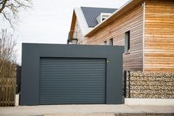 Modern garage door in black / gray