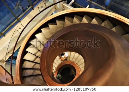 modern staircase with spiral staircase , spiral staircase in the modern building of the capital city #1283189950
