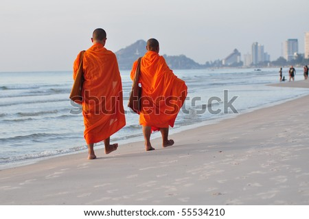 2 monks on the beach,Hua Hin Thailand - stock photo