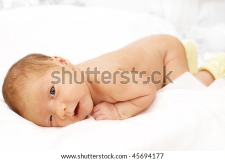 1 month baby trying  to crawl