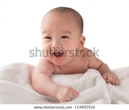 3-month old Asian American baby boy lay on the bed after bath laugh