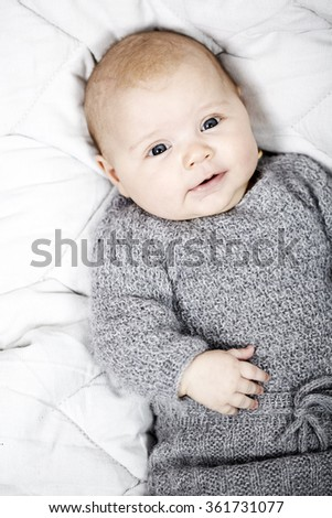 817bc4fbc Free photos 3 month old baby lying down wearing homemade knitted ...