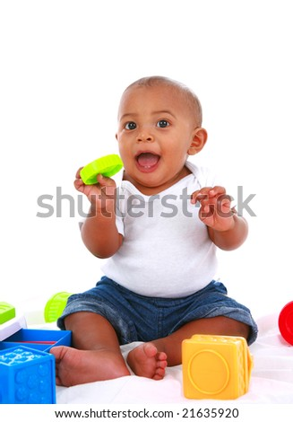 7-month old baby playing with toys on white background - stock photo